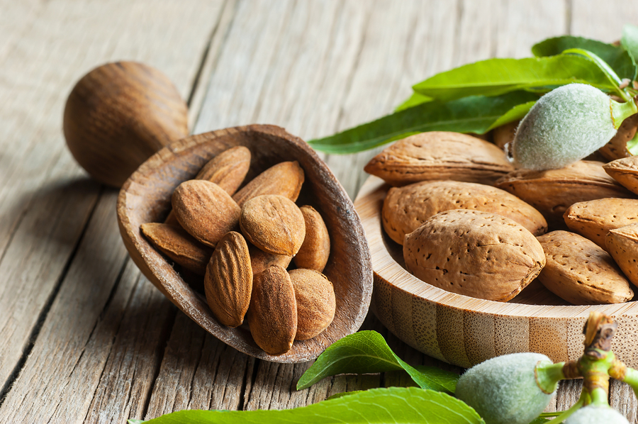 Almonds in a wooden scoop.