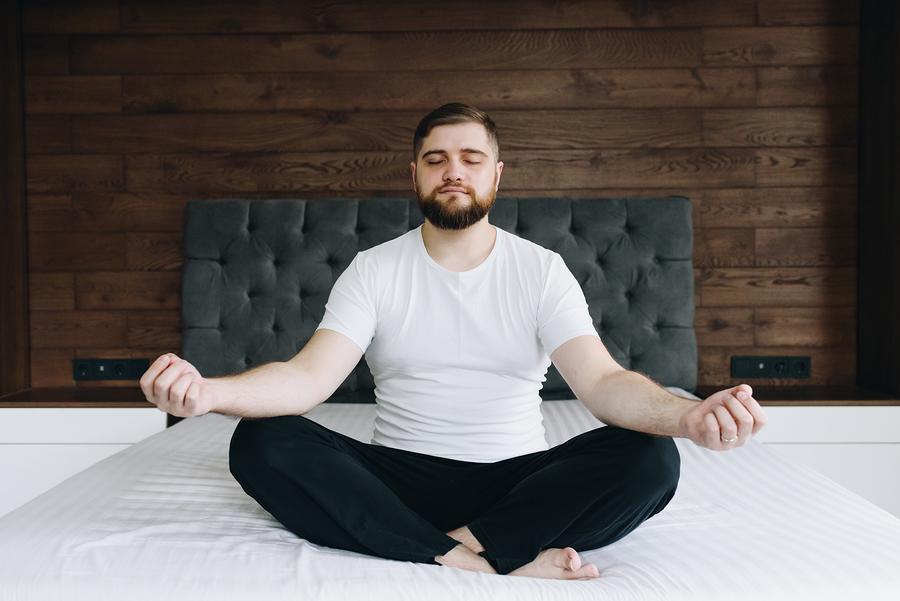 Man sitting cross legged in meditation.