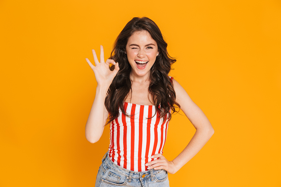Woman giving the OK sign with her right hand.