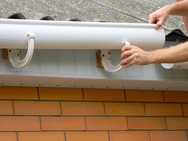 Installing gutters.