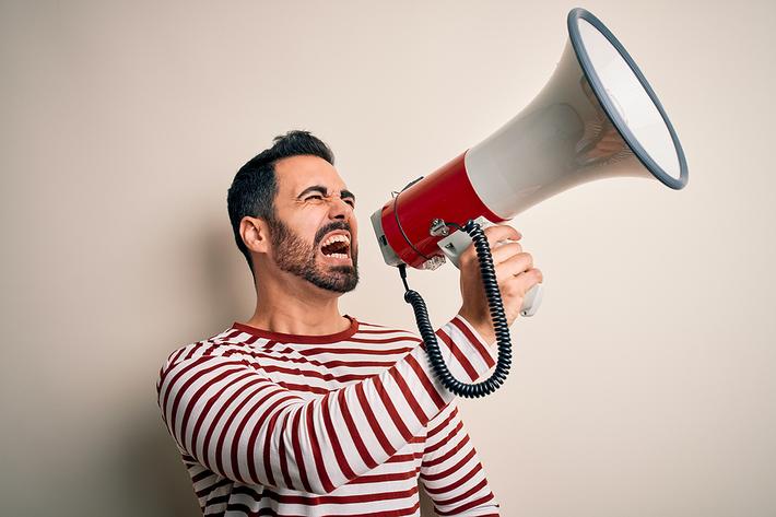 Man shouting into a megaphone.