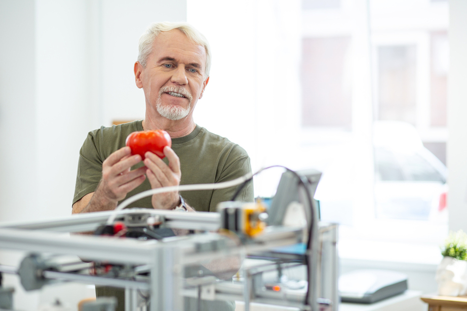 Man holding a tomato.