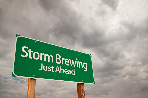 Sign labeled Storm Brewing Just Ahead.