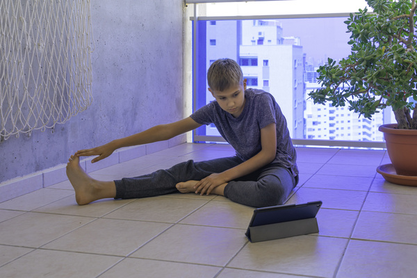 Teen stretching on the floor.