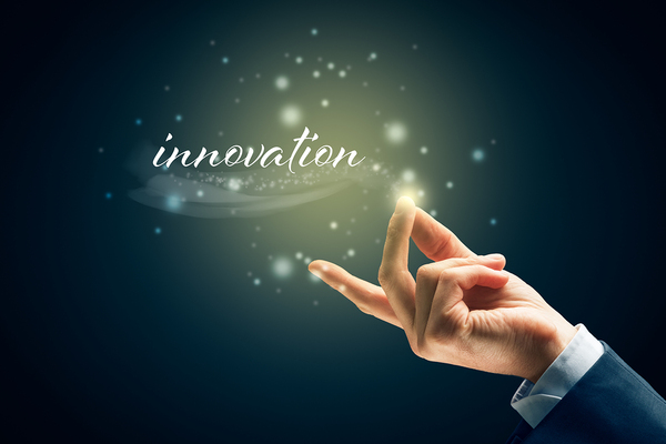 Person snapping their fingers under the word innovation.