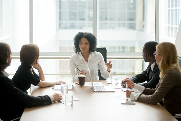 Woman presenting a topic to her colleagues.