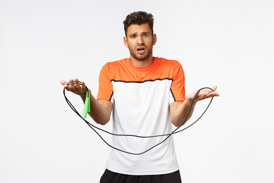 Man holding a jumprope.