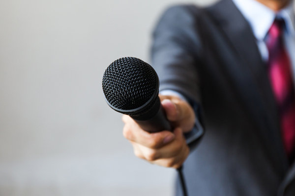 Man holding a microphone.