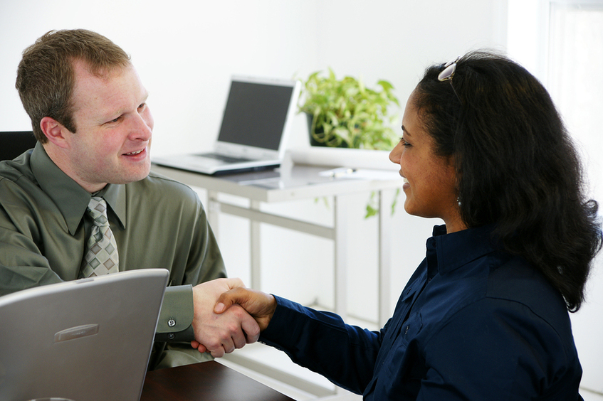 Interviewer shaking the hand of a employee candidate