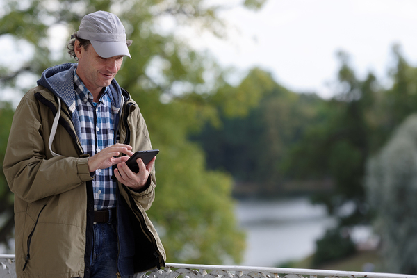 Rural outdoor man using tablet