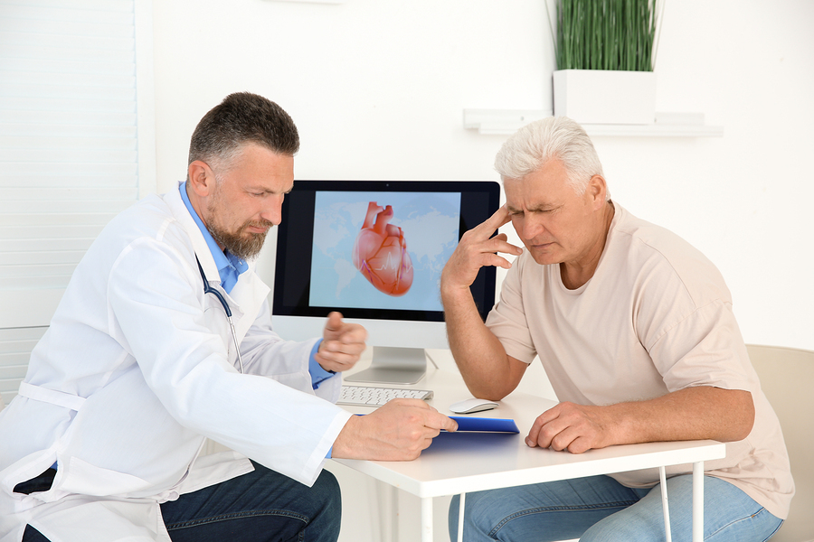 Physician discussing heart health with a male patient.