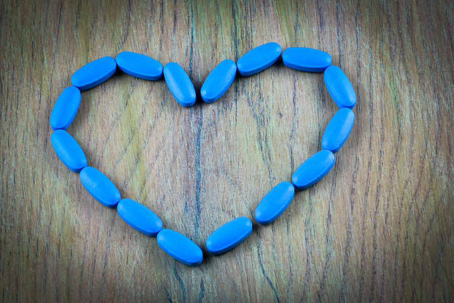 Blue pills formed into a heart shape.