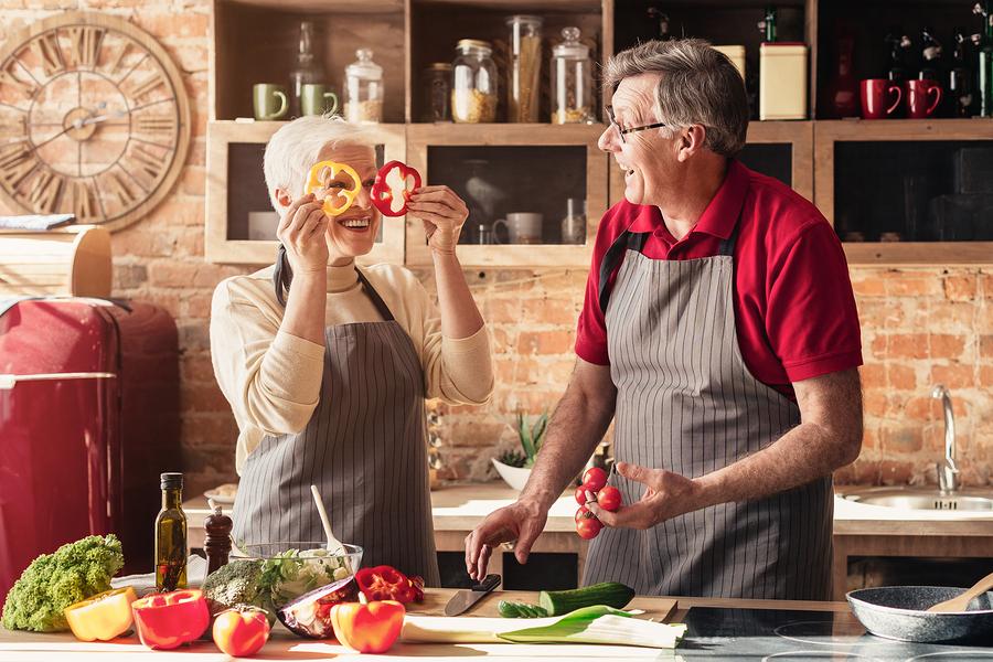 Older couple cooking together.