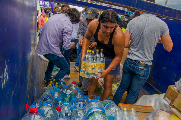 Group of aid workers organizing water bottles.