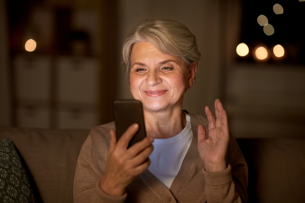 Smiling woman looking at her phone.