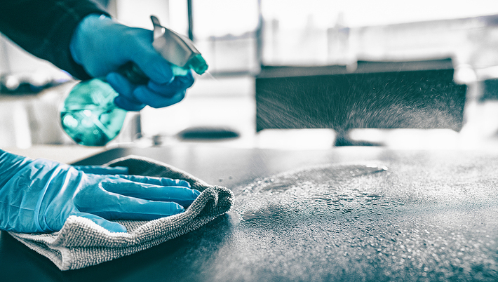 Cleaning exercise equipment.
