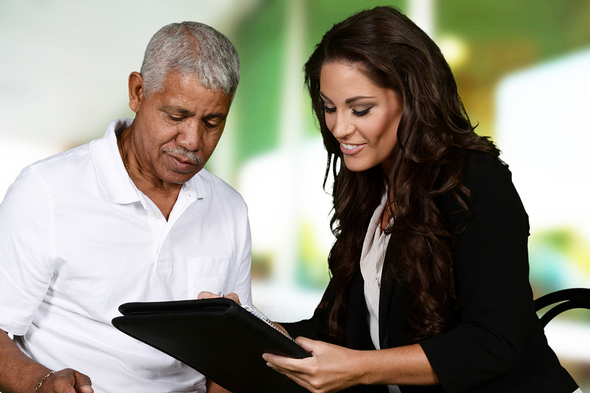 Business owner looking at paperwork with a lender.