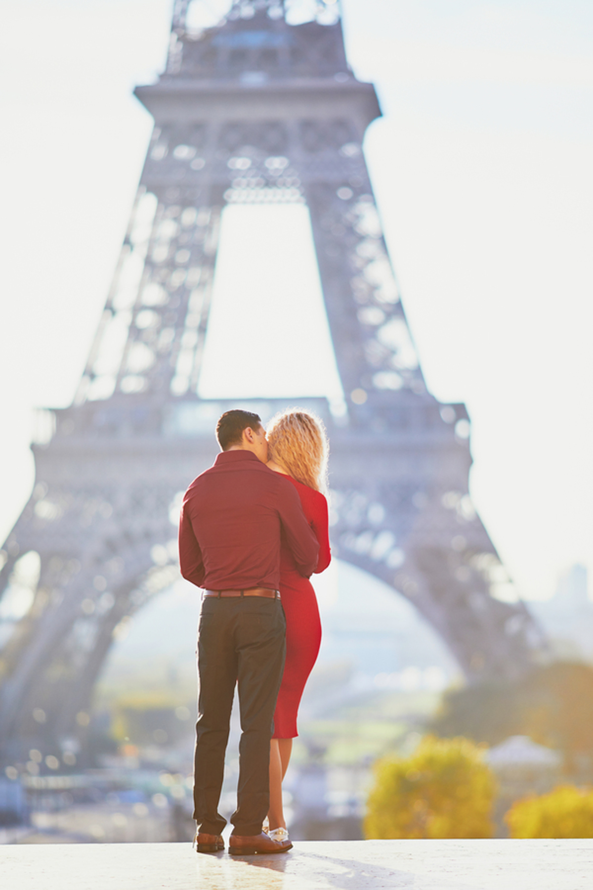 Couple hugging near the Eiffel Tower.