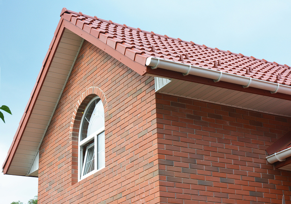 Brick house with tile roof.