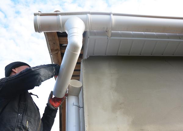 Man repairing a drain pipe.