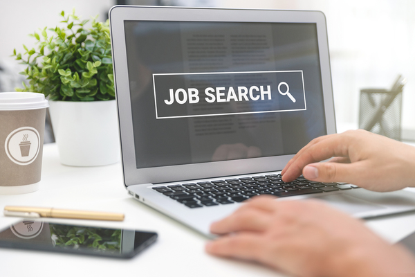 Performing a job search using a laptop computer.