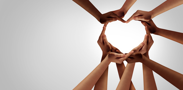 Group forming a heart shape with their hands.