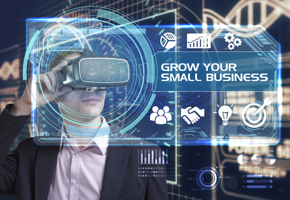 Man using a virtual reality headset looking at a digitally created graphic to grow your business.