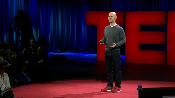 Adam Grant speaks on TED stage.