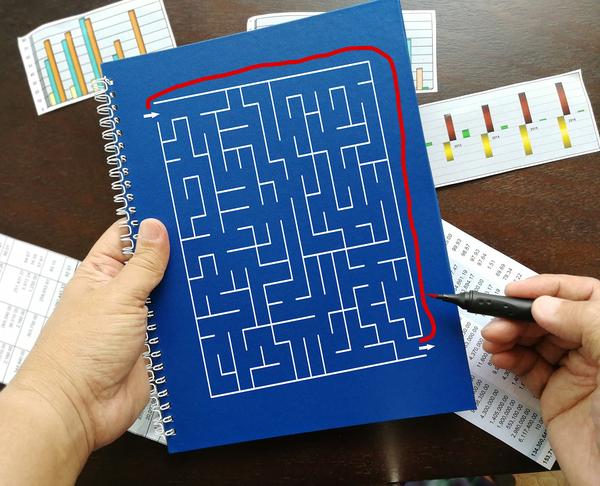 Person solving a maze.