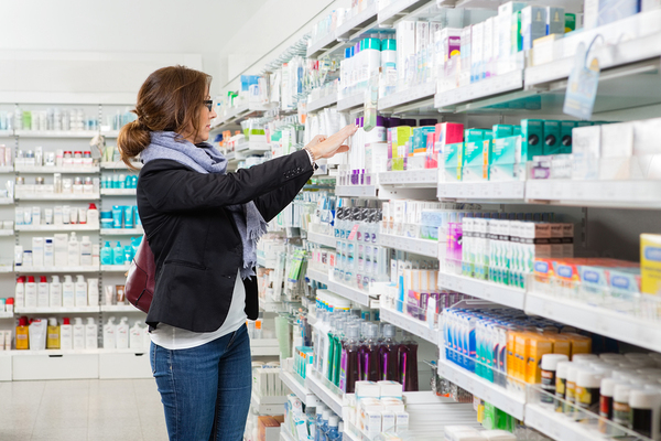 Woman shopping in a health and beauty isle.