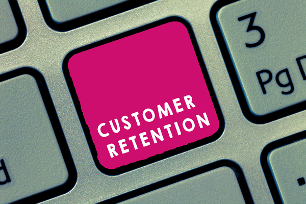 Computer keyboard key labeled customer retention