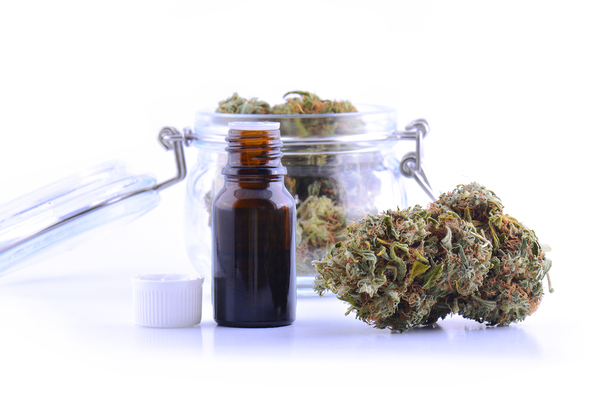 Glass jar with cannabis buds.
