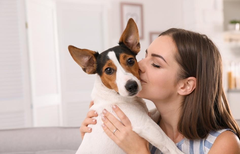 Woman hugging a dog.