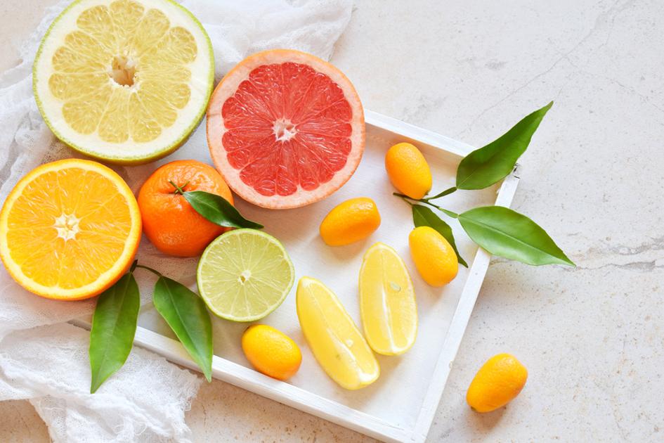 Fresh cut oranges, grapefruits, limes and lemons.