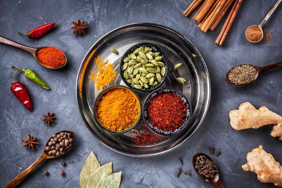 Spices in bowls and spoons.