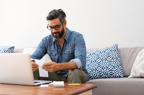 Mature casual man using a laptop