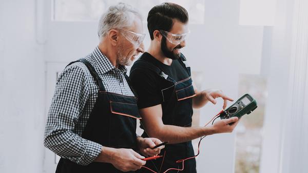 Younger worker seeking advice from an older worker.