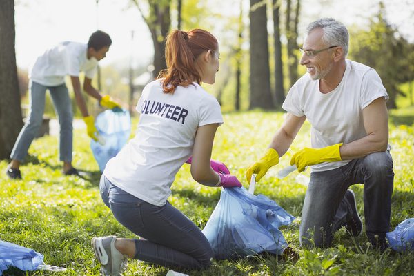 Volunteers cleaning up a park.