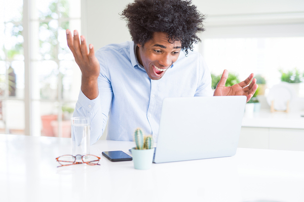 Man appearing surprised looking at this computer.