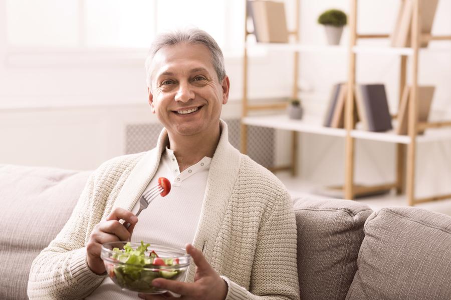 Man eating a health salad.