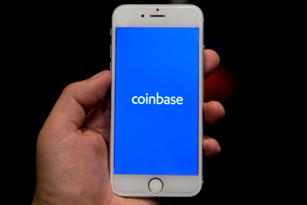 Mobile phone with coinbase app displayed.