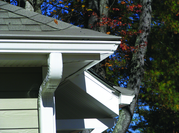 Corner of a house with gutters.