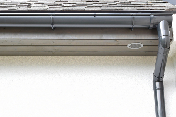 Home with gray gutter and downspout.