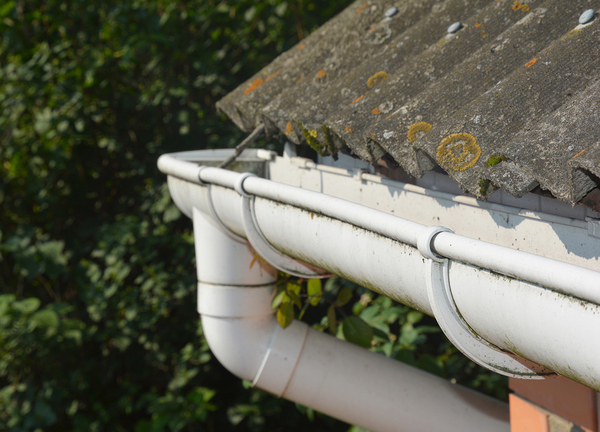Corner of a home with a gutter and downspout.