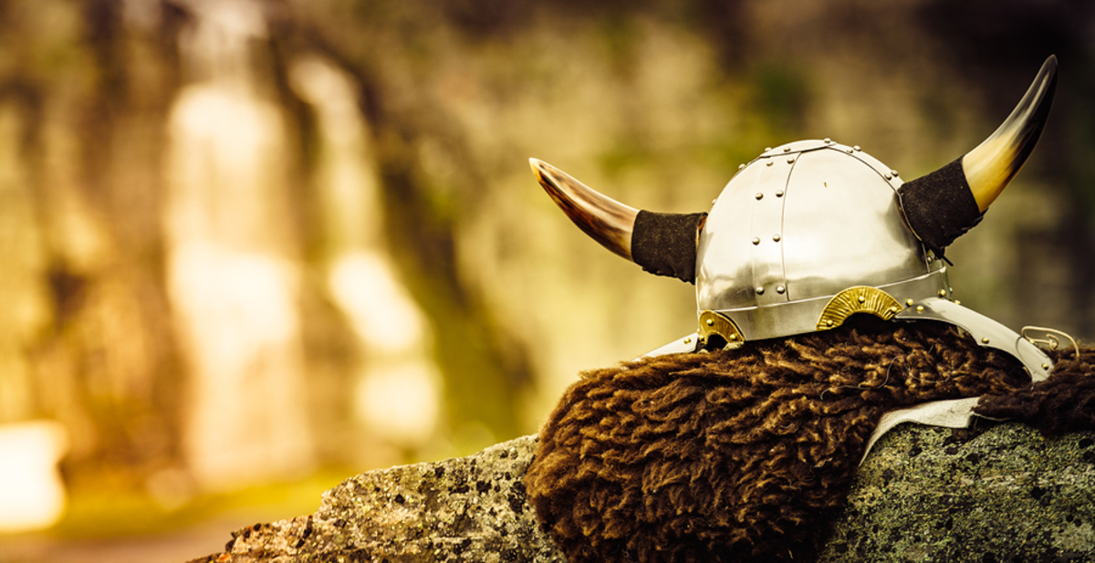 Viking helmet on a rock wall.
