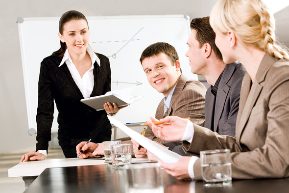Woman presenting to a group.
