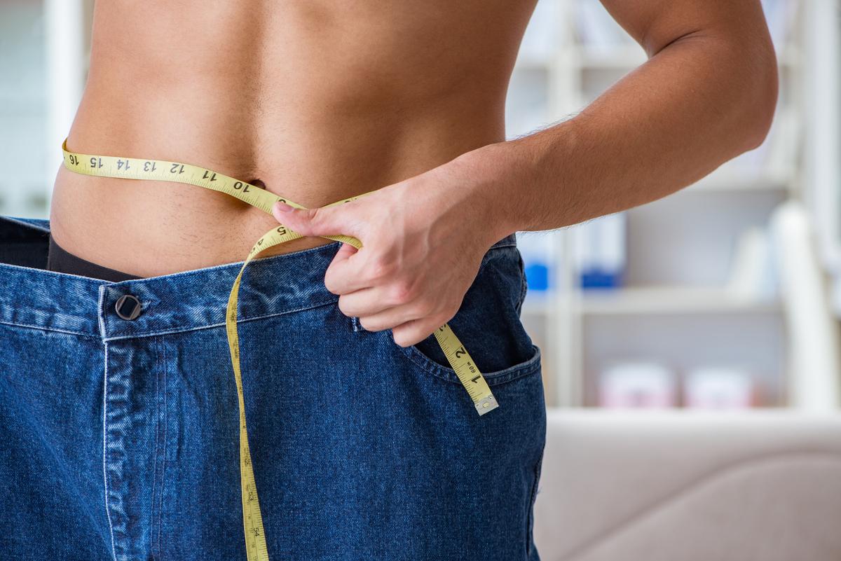 Man measuring his waist.