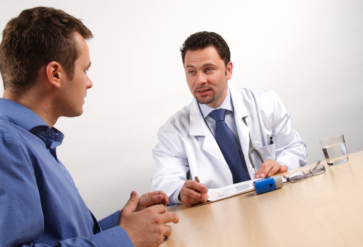 Man seeking consult from a medical doctor.
