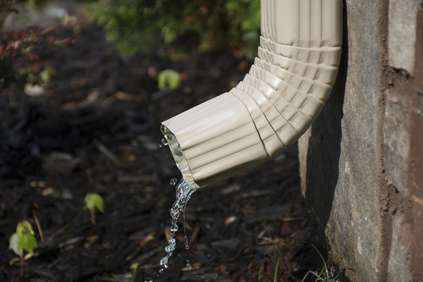 Downspout with water coming out.