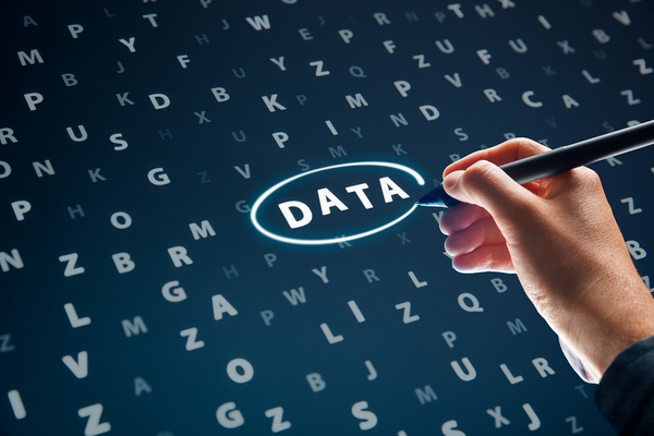 Person writing the word Data.